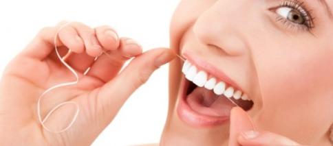 como usar la seda dental